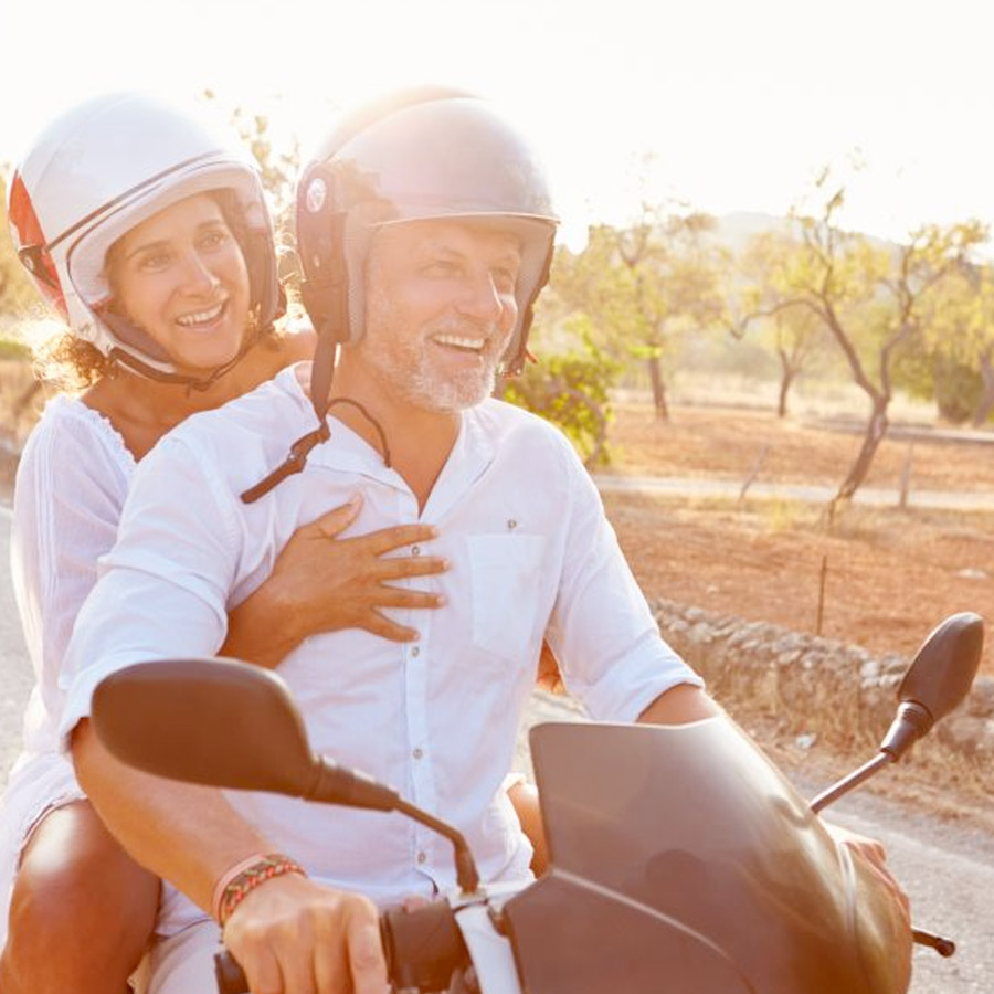Couple Riding Moped